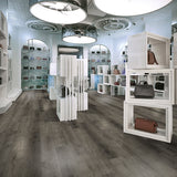 Smoke on the Water Loose Lay Vinyl Flooring from the Journey Collection by Divine installed inside a woman's handbag boutique