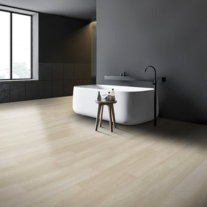 White Rabbit Loose Lay Vinyl Plank Flooring from the Journey Collection by Divine installed in a minimalist bathroom