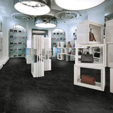 Retail hand-bag boutique with Bombshell black marble luxury vinyl tile flooring