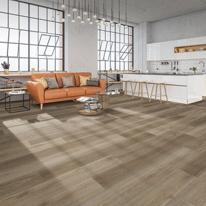 Burning Cain XL Luxury Vinyl Flooring in an industrial loft with tan leather couch and white kitchen cabinets