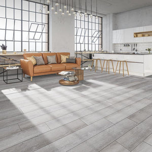 Quest Chasing Ice Oak Luxury Vinyl in a modern loft