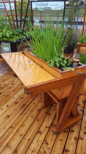 Self-Watering elevated community garden. Cedar raised beds, container gardens, and veggie/vegetable gardens featuring GardenWell sub-irrigation to create wicking beds for growing your own food.