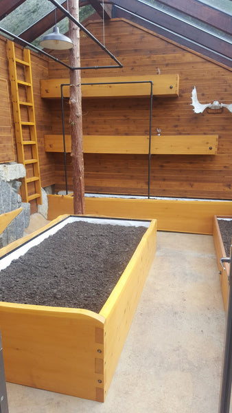 Self-Watering elevated greenhouse garden. Cedar raised beds, container gardens, and veggie/vegetable gardens featuring GardenWell sub-irrigation to create wicking beds for growing your own food.