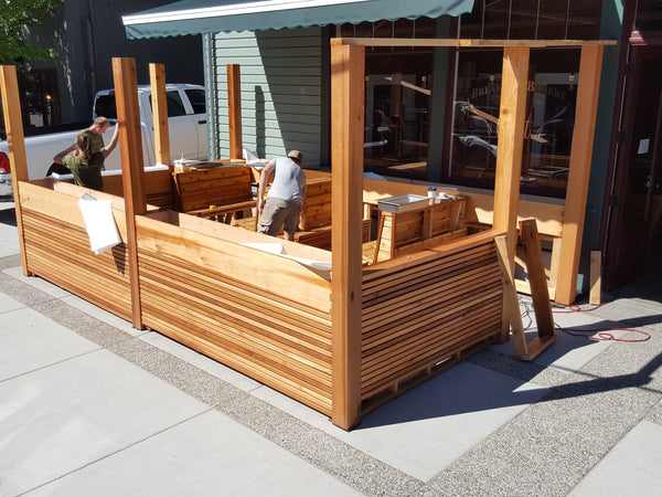 Self-Watering elevated restaurant garden. Cedar raised beds, container gardens, and veggie/vegetable gardens featuring GardenWell sub-irrigation to create wicking beds for growing your own food.