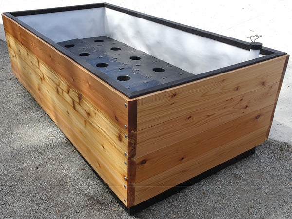 Self-Watering elevated artifex garden. Cedar raised beds, container gardens, and veggie/vegetable gardens featuring GardenWell sub-irrigation to create wicking beds for growing your own food.