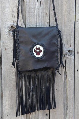 Black fringed handbag, beaded wolf paw design