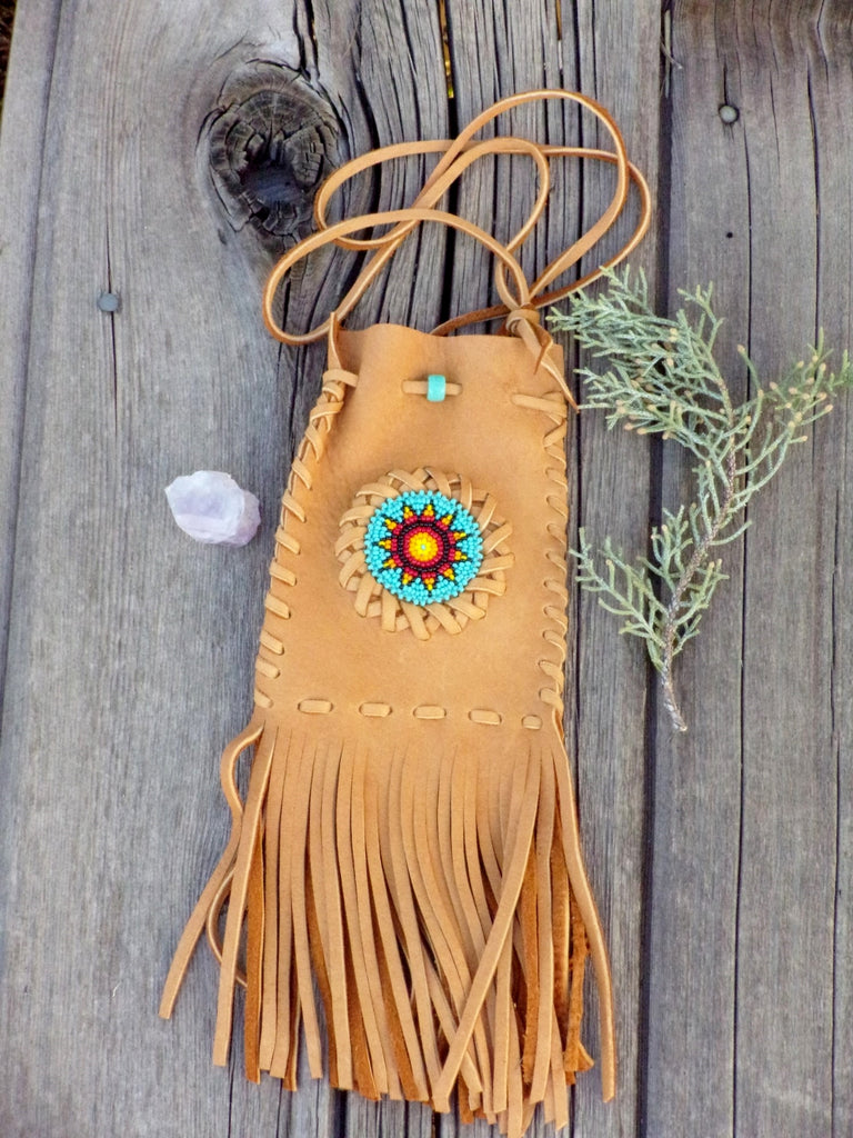 Fringed leather amulet bag, sunflower beadwork