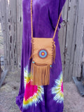 Fringed leather handbag with a beaded starburst rosette design , custom designed