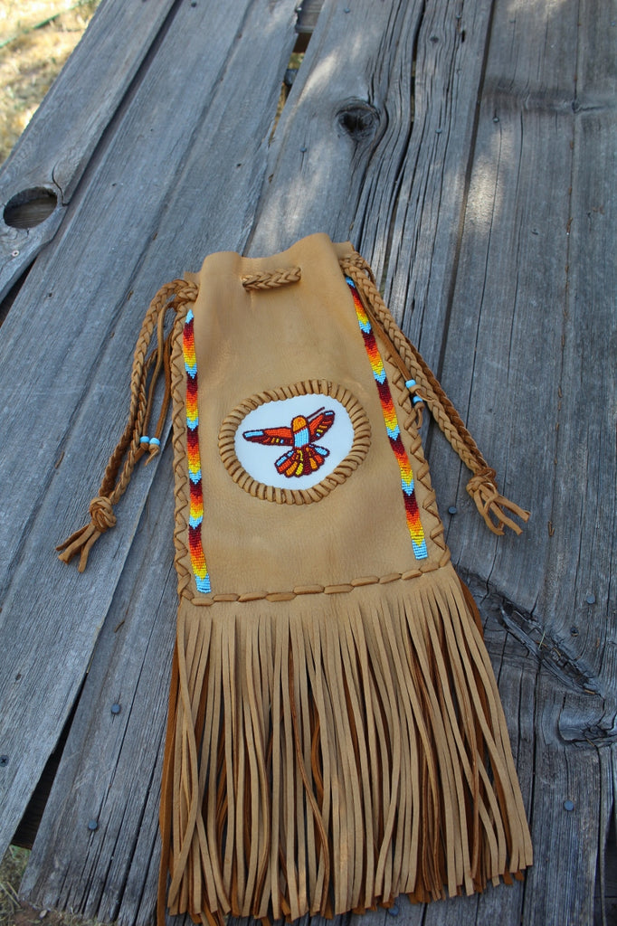 Fringed leather bag, beaded hummingbird, pipe bag