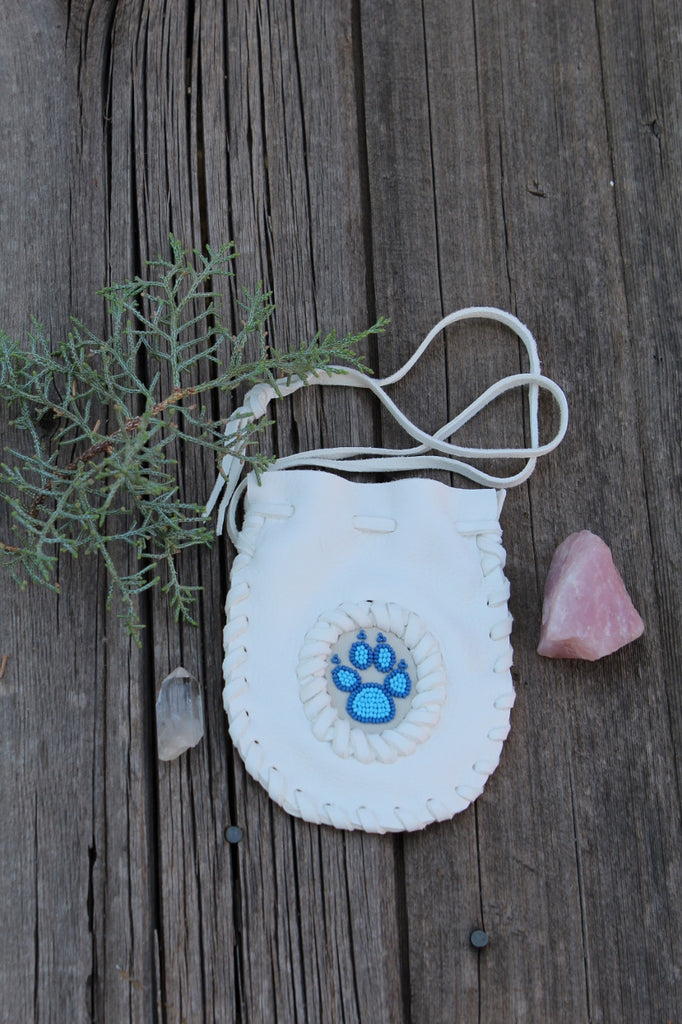 Beaded wolf paw medicine bag, white buckskin pouch