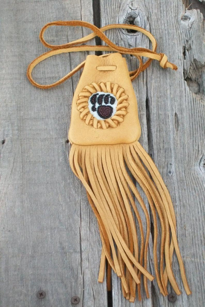 Fringed medicine bag with bear paw totem, leather neck pouch