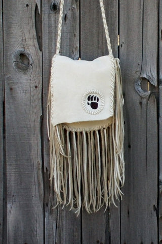 Fringed leather handbag with bear paw totem, totem handbag