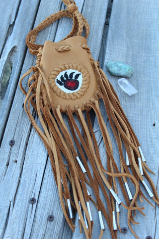 Fringed leather medicine bag, beaded bear paw pouch