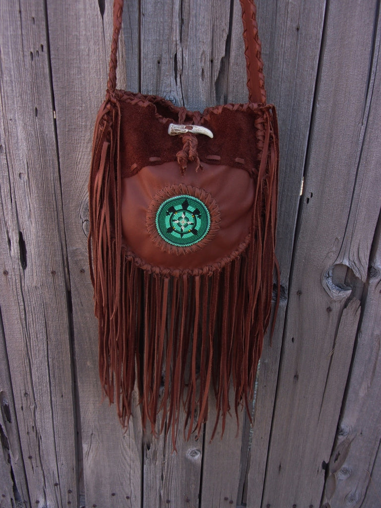 Fringed leather tote with beaded turtle