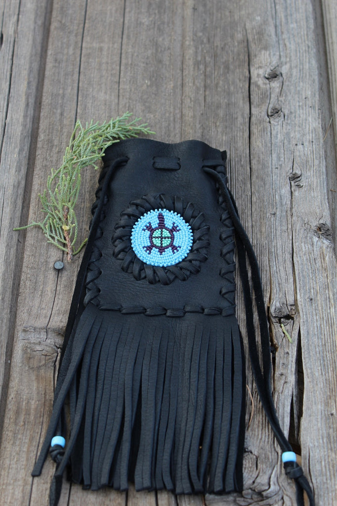 Fringed leather bag with beaded turtle totem