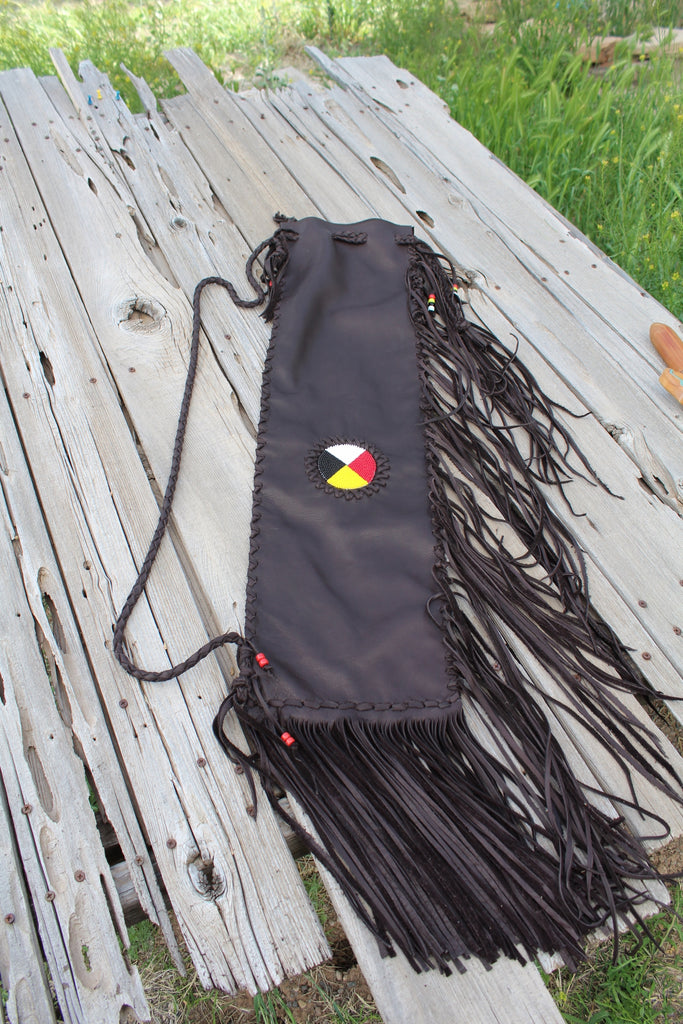 Fringed leather flute bag with beaded medicine wheel