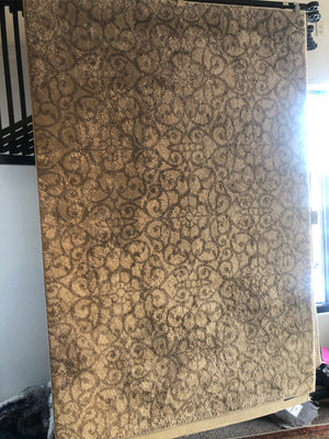 Tan and gray patterned area rug