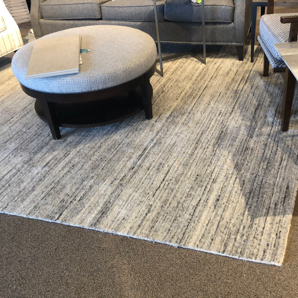 Gray and cream textured area rug