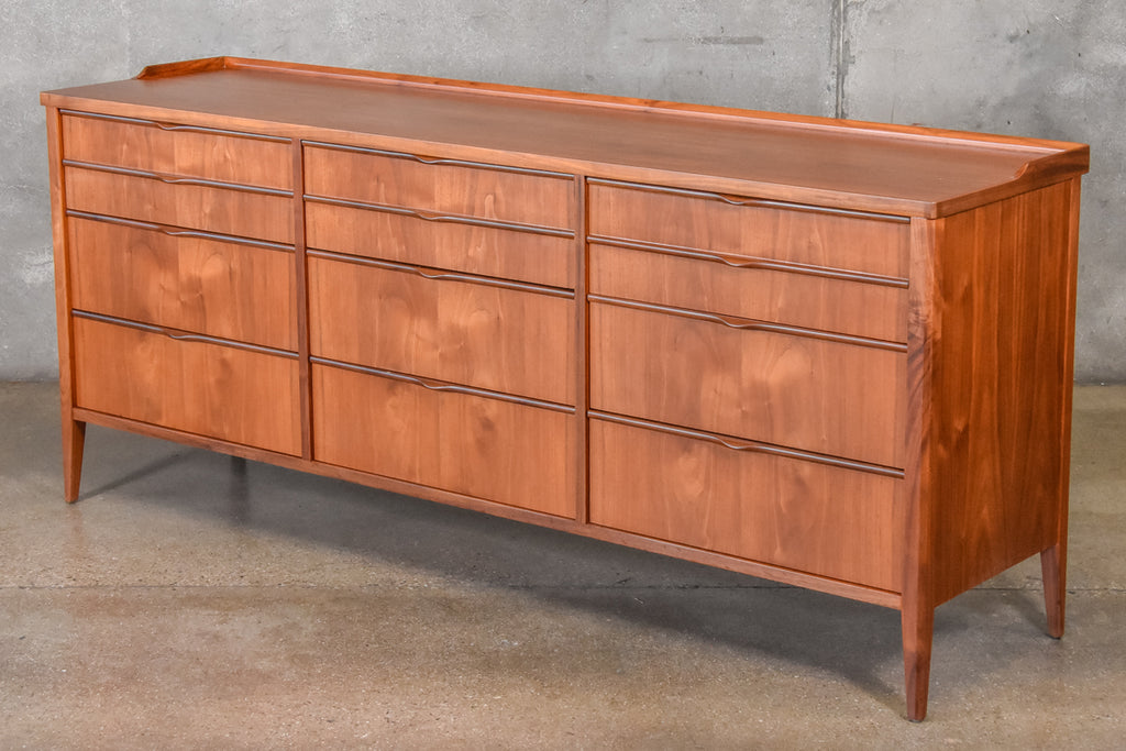 Nine Drawer Sculptural Walnut Dresser