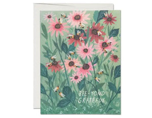 greeting card with flowers and bees. text reads bee-yond grateful