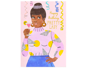 woman wearing a purple sweater and blue skirt, holding pink cocktail and toasting - happy birthday pretty lady