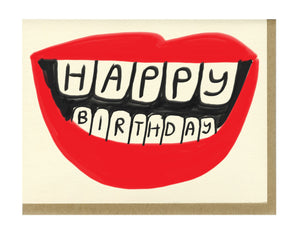 red lips with happy birthday written on the teeth
