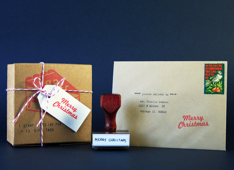 envelope with typed address, merry christmas stamp and kit boxed up.
