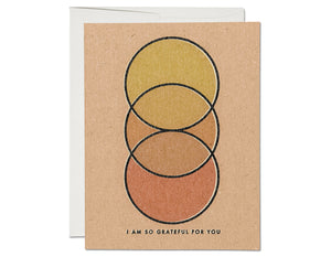 overlapping circles in beautiful muted colors yellow, orange, deeper orange. text reads i am so grateful for you