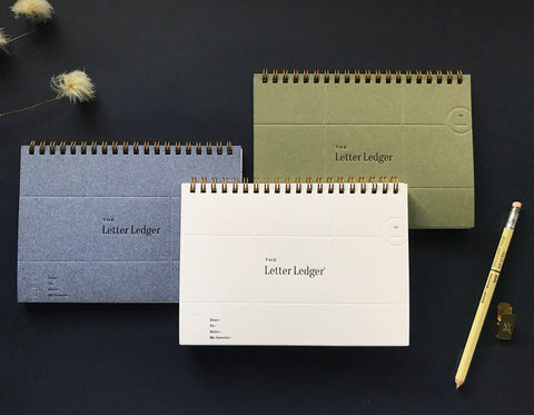 a 5x7 wire-bound booklet to record all of your correspondence. Comes in three different color covers- speckled white, olive green, postal pants blue. The perfect accessory for any pen pal!