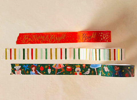set of three holiday themed washi tapes from rilfe paper co. red backgorund with gold lettering be merry & bright. colorful watercolor stripes, and nutcracker characters.