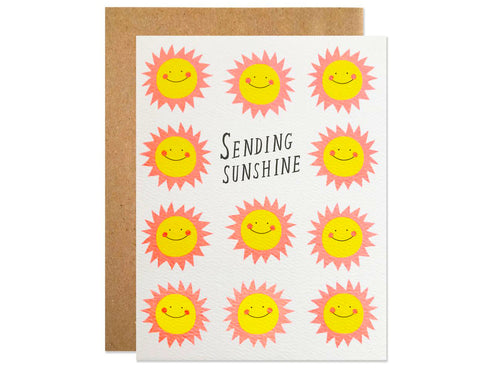 rows of neon colored smiling sunshines in pink and yellow. text reads sending sunshine