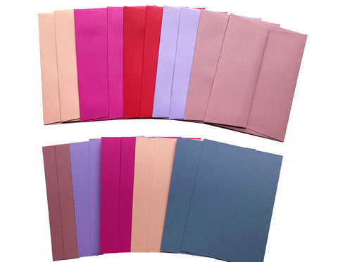 set of envelopes and cards in hot pink, lavender, bright red, dusty rose and dusty blue.