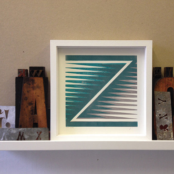 Styled shot of framed Zulu Z print