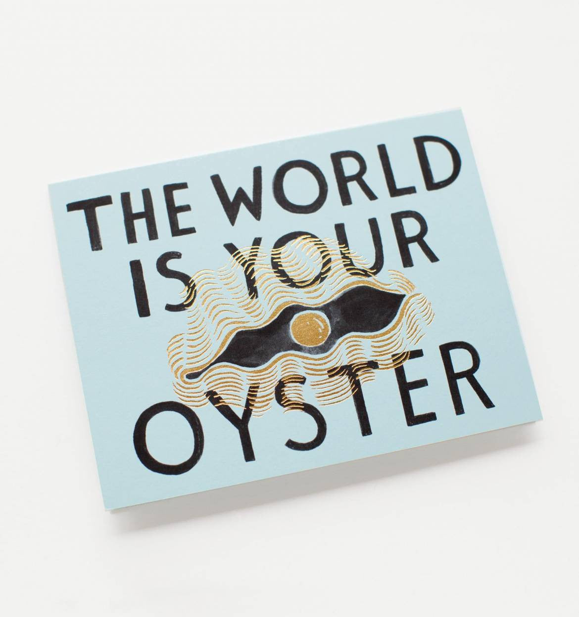 Angled shot of The World is Your Oyster gift card