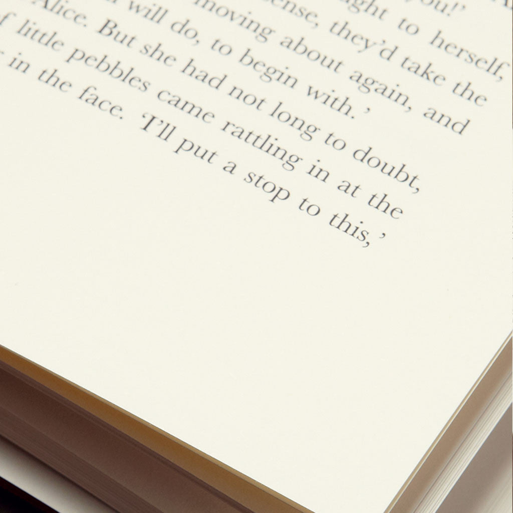 Close up shot of text inside Alice in Wonderland
