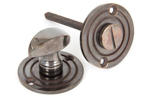 From the Anvil Antique Brass Round Bathroom Thumbturn