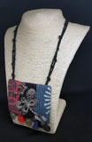 Fabric neck piece with coins