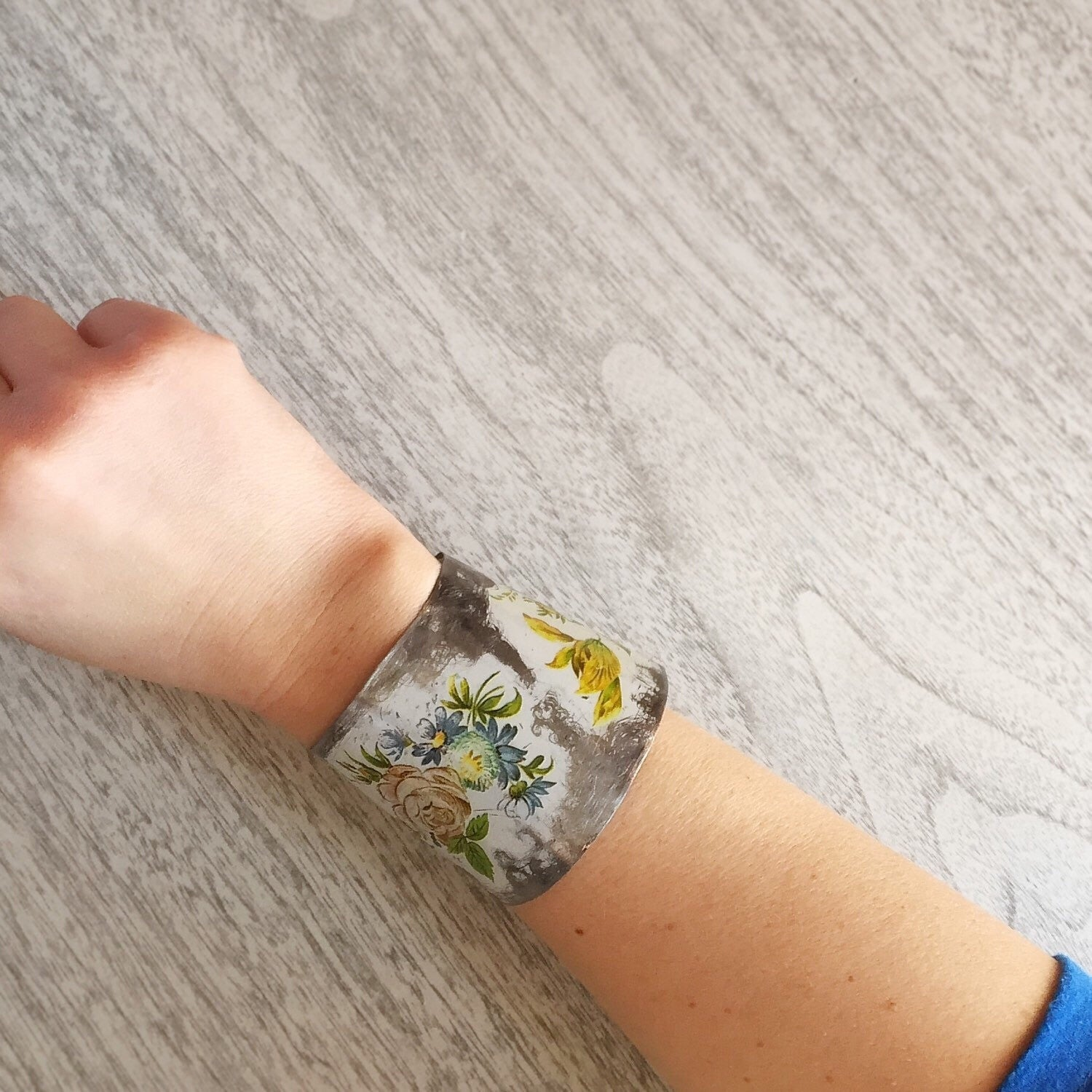 Recycled Vintage Tin Jewelry - Distressed Floral cuff Bracelet On wrist