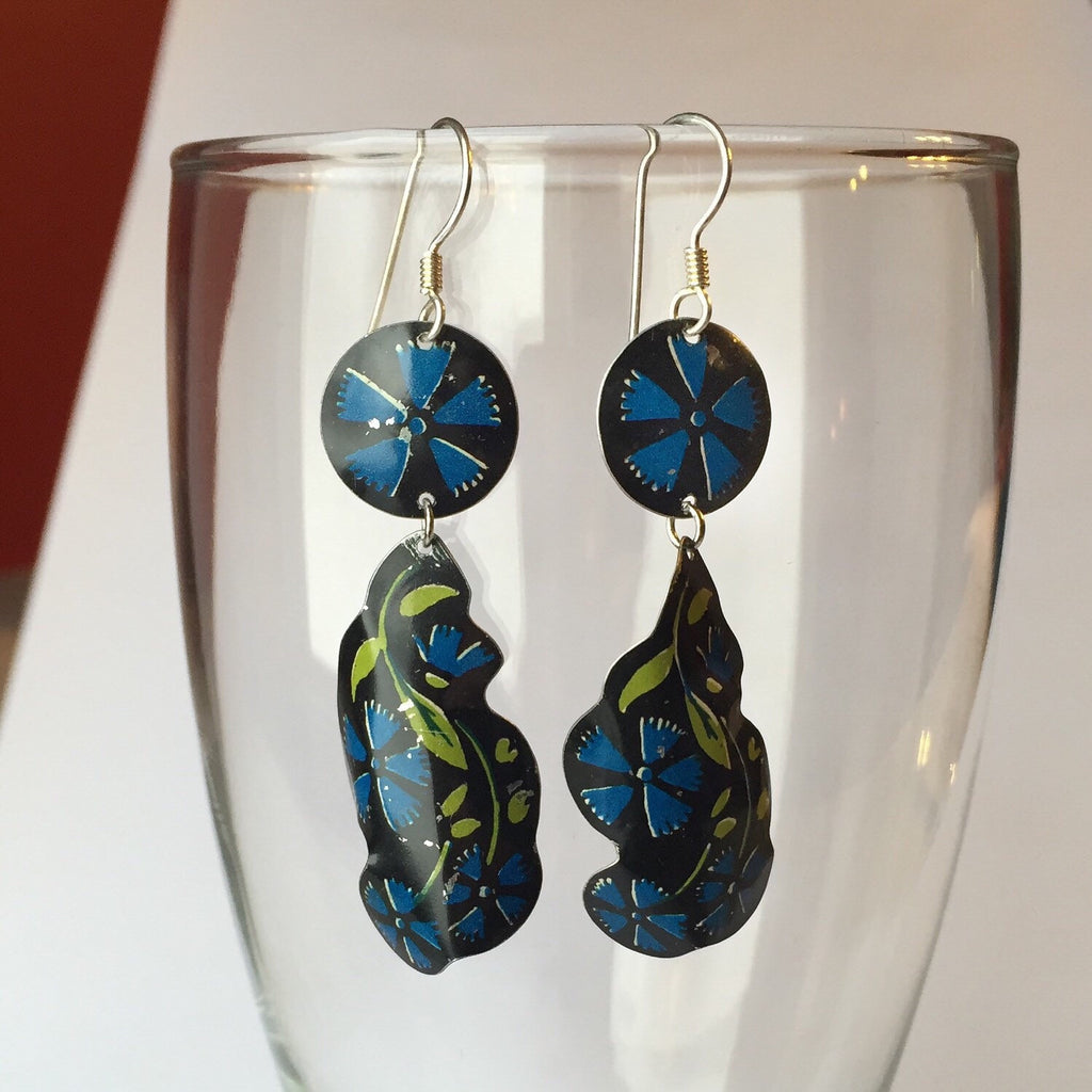Tin Jewelry - Black and Blue Floral Dangle Earrings on Glass Display