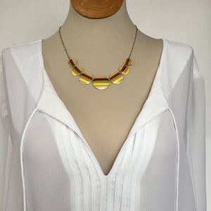 Recycled Tin Jewelry - Necklace Retro Color Stripes on model with shirt