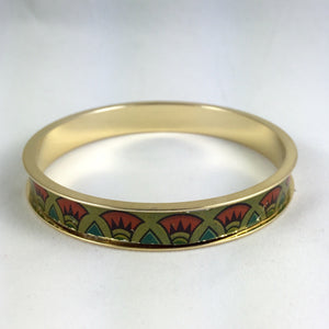 1 - 24kt gold plated bangle fitted with a with vintage tin inlay.  The biscuit tin design includes Egyptian style red and green flowers.  The inside measurement of the bangles is approximately 7 3/4''. around.