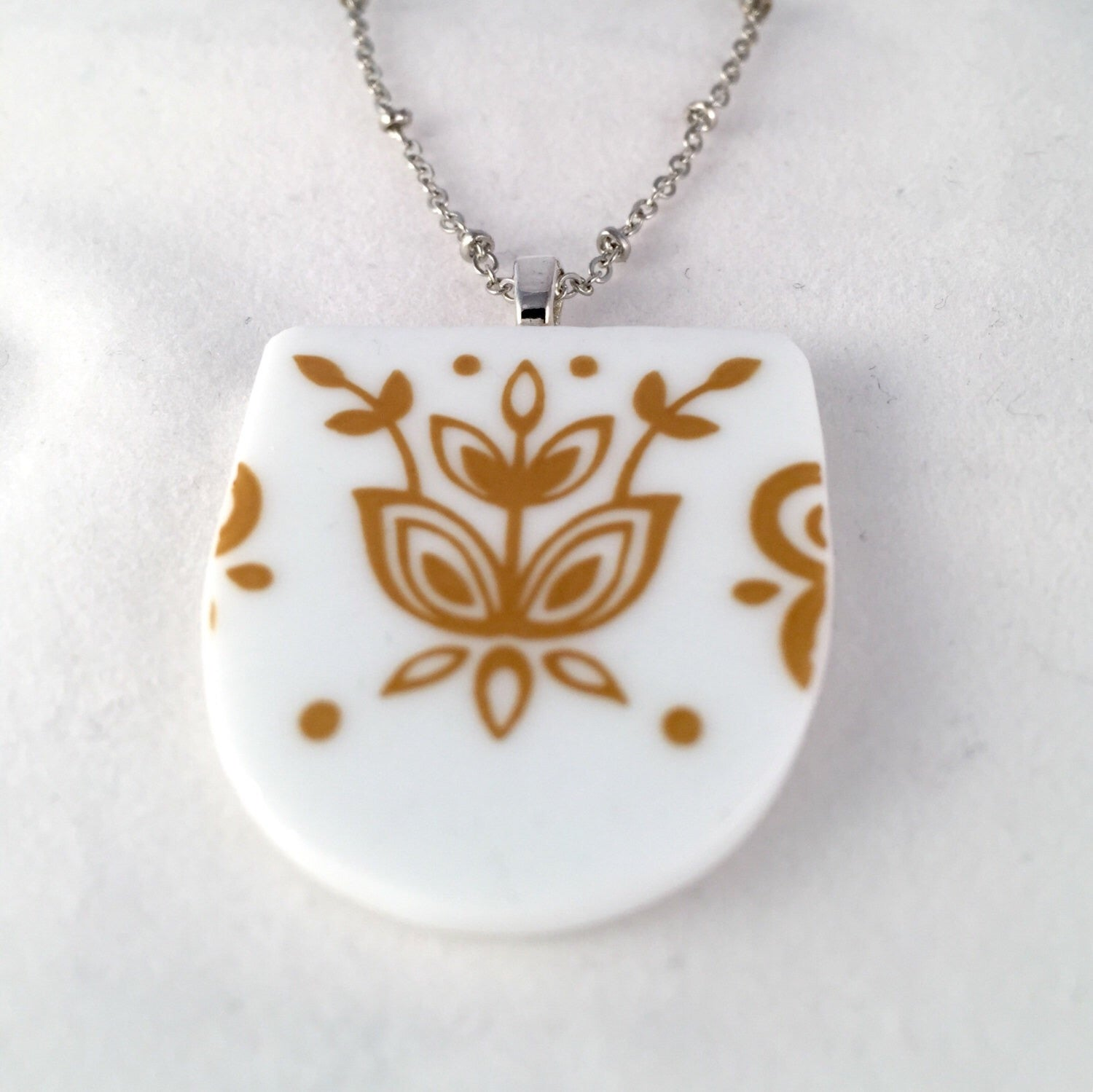Broken China Jewelry - Corelle Necklace in Butterfly Gold Pattern Close up image