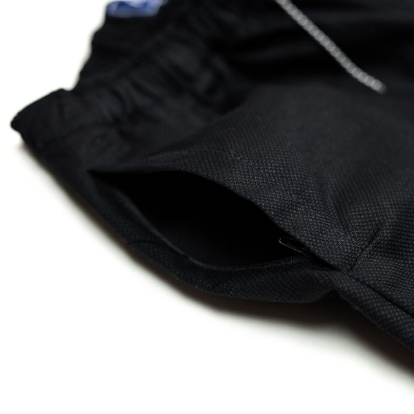 WITNESS tracksuit pants – black