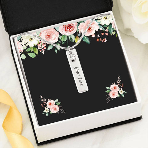 Engraved vertical name plate necklace coupled with dangling birthstone. Choose name and birthstone. Made of polished surgical steel, snake chain, and lobster claw clasp.  Comes in beautiful gift box on a dark gray card with pink roses at top and sides.