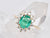 A Marisol ring with a vintage emerald