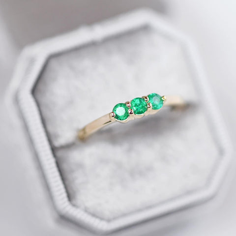 An emerald Lily three stone wedding ring