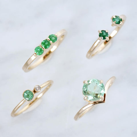 Four emerald rings