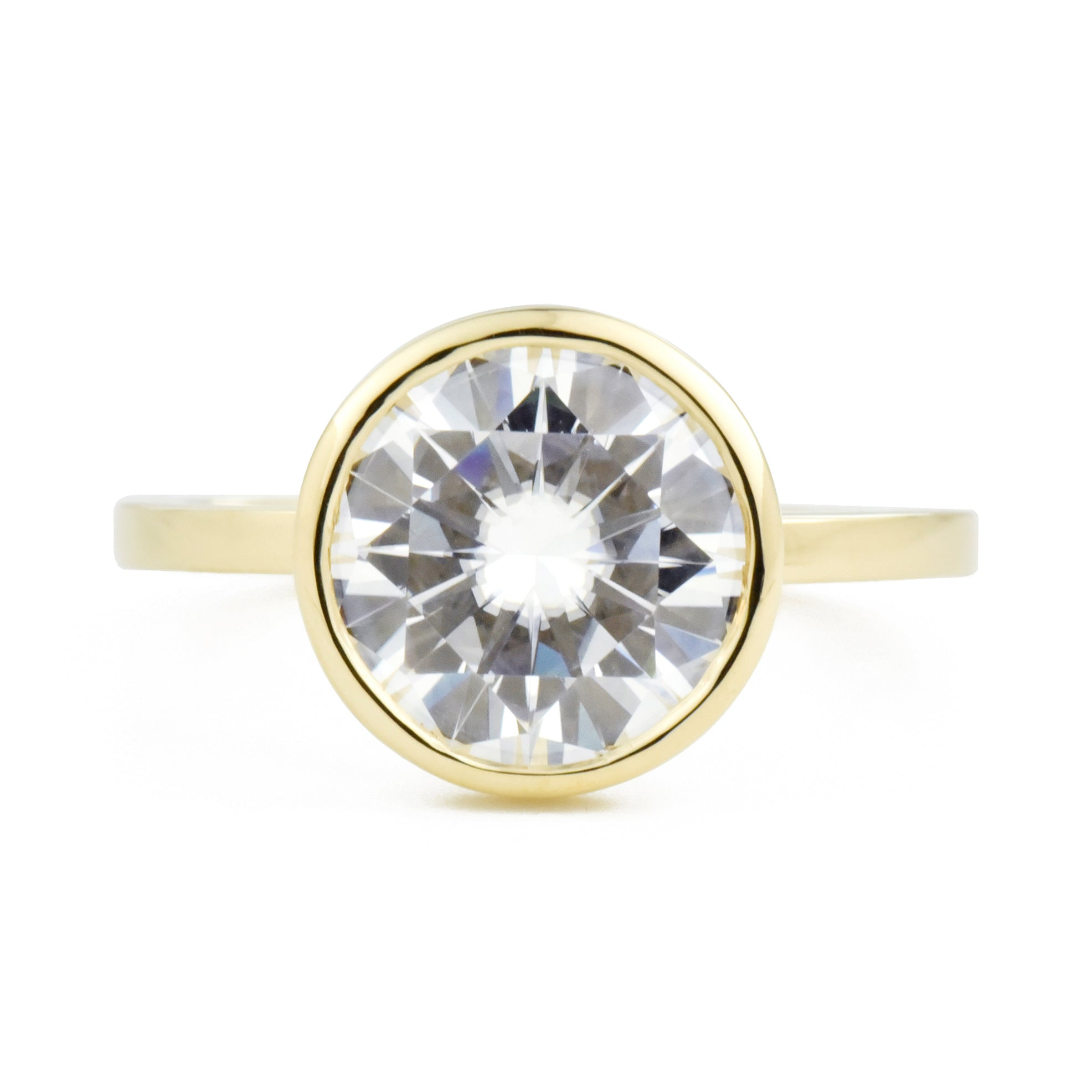 Aura Round Bezel 2.7ct Moissanite Engagement Ring in yellow gold