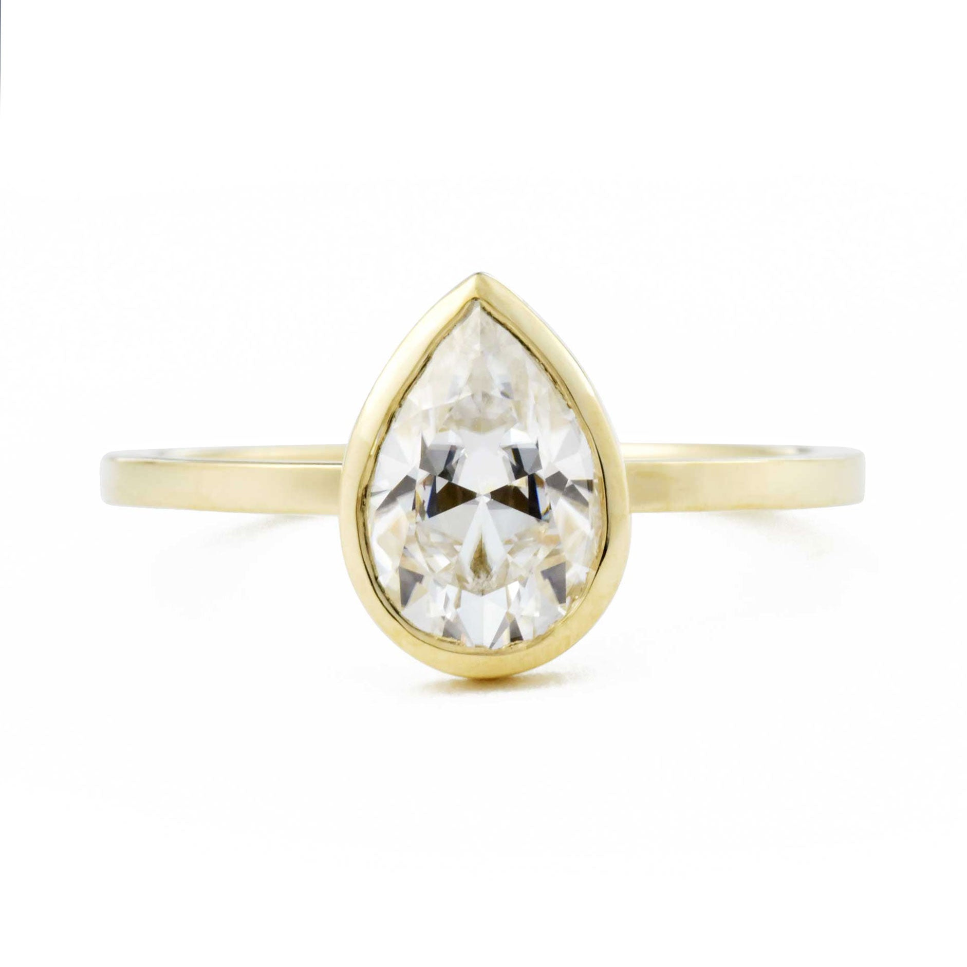 Aura Pear Bezel 1.5ct Moissanite Engagement Ring in yellow gold
