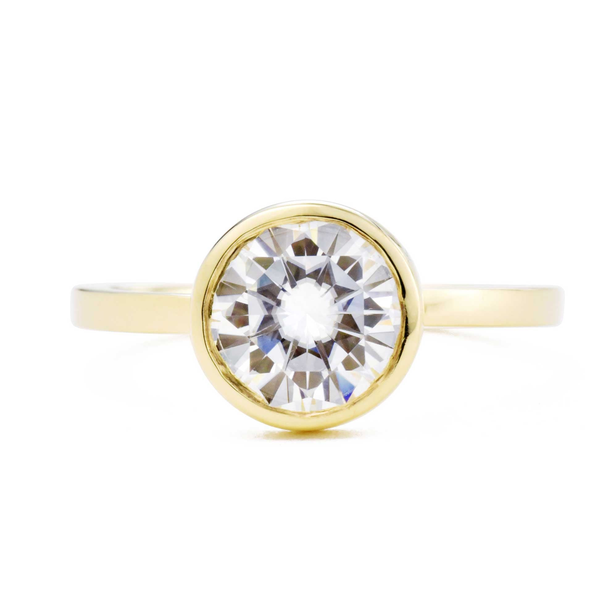 Aura Round Bezel 1.5ct Moissanite Engagement Ring in yellow gold